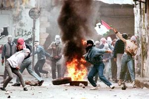 "(FILES) Palestinians demonstrators throw rocks, 29 January 1988 in Nablus, at Israeli soldiers during violent protests gainst the Israeli occupation. The Palestinian uprising, ""intifada"" (""war of stones"") against Israeli occupation of Palestinian areas broke out on December 1987 and lasted until 1993 when the Oslo peace accords were signed."